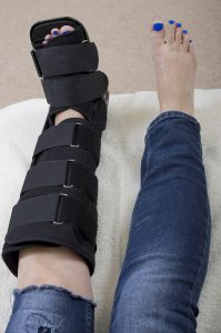 Runner wearing a fracture walking boot